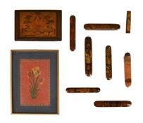 Six Qajar papier-mache pen cases (Qalamdan)