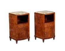 A pair of Art Deco walnut and marble topped bedside cabinets