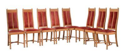 A mixed hardwood circular dining table