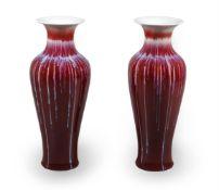A pair of modern Asian porcelain sang du boeuf glazed baluster vases