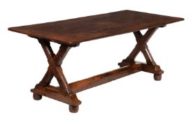 An oak dining table in the Arts & Crafts style