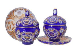 A pair of clear, opaque-white, and blue glass overlay bowls, covers and stands