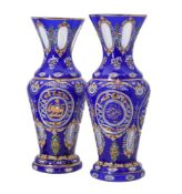 A pair of clear, opaque-white, and blue glass overlay baluster vases