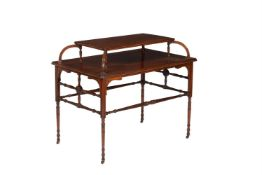 An Aesthetic movement mahogany two tier centre table