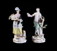 A pair of Meissen figures of a shepherd and shepherdess