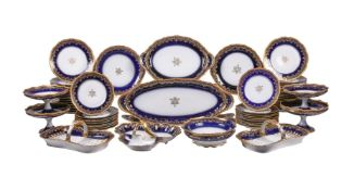 A Limoges porcelain blue and gilt part dinner service retailed by Emile Bourgeois