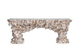 Y A sculptural chromed metal side table