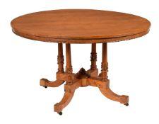 An Aesthetic Movement bird's-eye maple centre table
