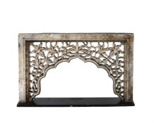 A carved and pierced marble arch