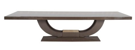 A lacquered Obeche wood dining table