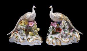 A pair of Derby (Rbt. Bloor) models of peacocks