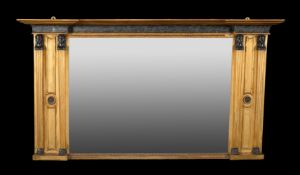 An Egyptian Revival giltwood wall mirror