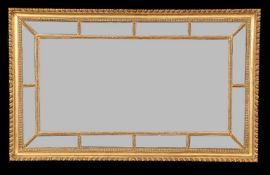 A giltwood marginal wall mirror