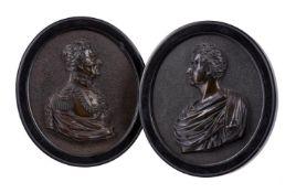A pair of bronze oval portrait plaques