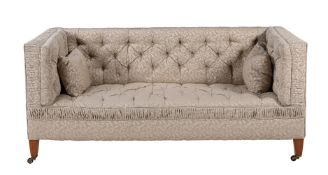A Victorian walnut and upholstered sofa