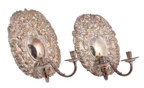 A pair of Dutch style brass wall lights
