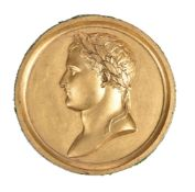A signed and gilded lead medallion of Napoleon as Emperor. French