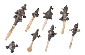 Y A collection of eight silver mounted rattles
