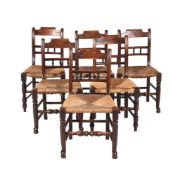 A set of six stained and turned chairs