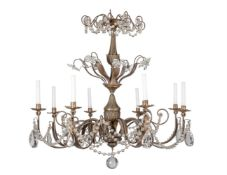 A patinated and glass eight light chandelier