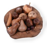 A collection of twelve pieces of turned wood fruit