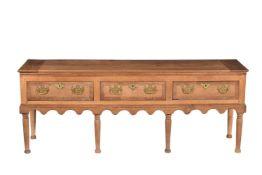 An oak and burr elm banded dresser base