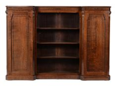 A Victorian oak and inlaid breakfront bookcase