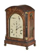 A mahogany and brass inlaid mantle clock