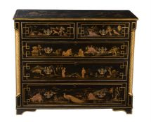 A black and gilt chinoiserie painted chest of drawers