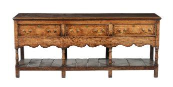 A George III oak and elm dresser base