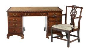 A mahogany twin pedestal desk in George III style