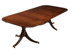 A George III mahogany twin pillar dining table