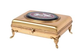 A gilt metal box set with an Italian micromosaic panel decorated with doves and a nest of flowers