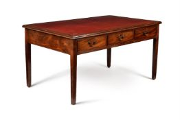 A George III mahogany and tooled leather inset library table