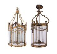 Two gilt metal and glass hall lanterns