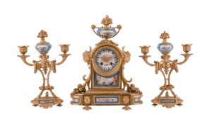 A French gilt metal and Sevres style porcelain mantel clock garniture
