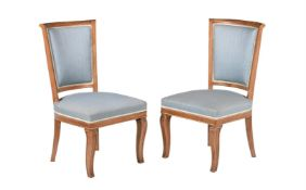 A pair of mahogany, parcel gilt and upholstered side chairs, in Empire style