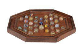 A mahogany peg solitaire or Solo Noble board
