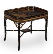 A black lacquered papier-mache tray on stand