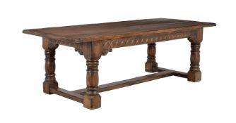 A carved oak refectory table in 17th century style