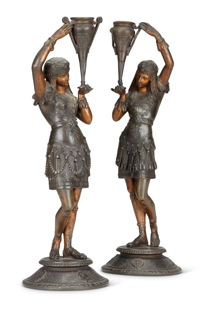 A PAIR OF CONTINENTAL ART DECO FIGURAL METAL CANDLE HOLDERS