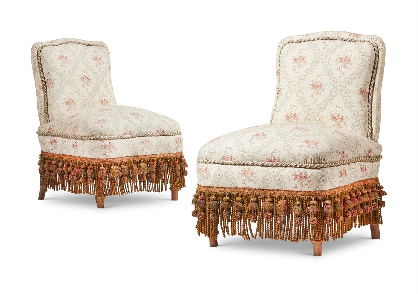 A PAIR OF VICTORIAN LOW UPHOLSTERED SIDE CHAIRS