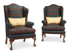 A PAIR OF GEORGE III STYLE UPHOLSTERED WING ARMCHAIRS