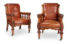 A PAIR OF VICTORIAN CARVED OAK LIBRARY ARMCHAIRS