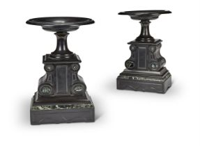 A PAIR OF SERPENTINE AND SLATE GARNITURE URNS