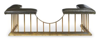 A BRASS AND LEATHER UPHOLSTERED CLUB FENDER