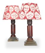 A PAIR OF MAHOGANY AND GILT-METAL COLUMNAR TABLE LAMPS
