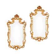 A PAIR OF CARVED GILTWOOD WALL MIRRORS IN GEORGE III STYLE
