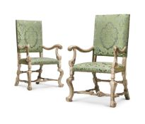 A PAIR OF CARVED WOOD, PAINTED AND SILVERED ARMCHAIRS