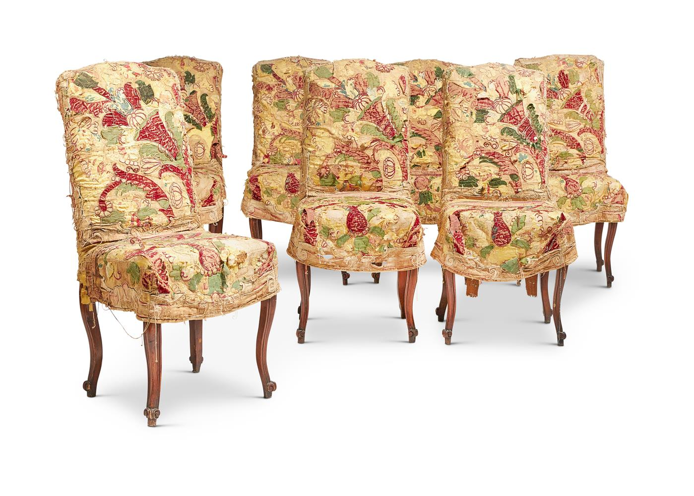 A SET OF FOURTEEN LOUIS XV STYLE WALNUT AND UPHOLSTERED SIDE CHAIRS